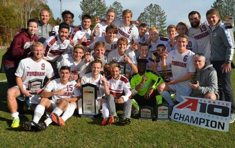 The men's soccer team poses after winning their second A-10 Championship in three years, and third all-time. (Courtesy of Fordham Athletics).
