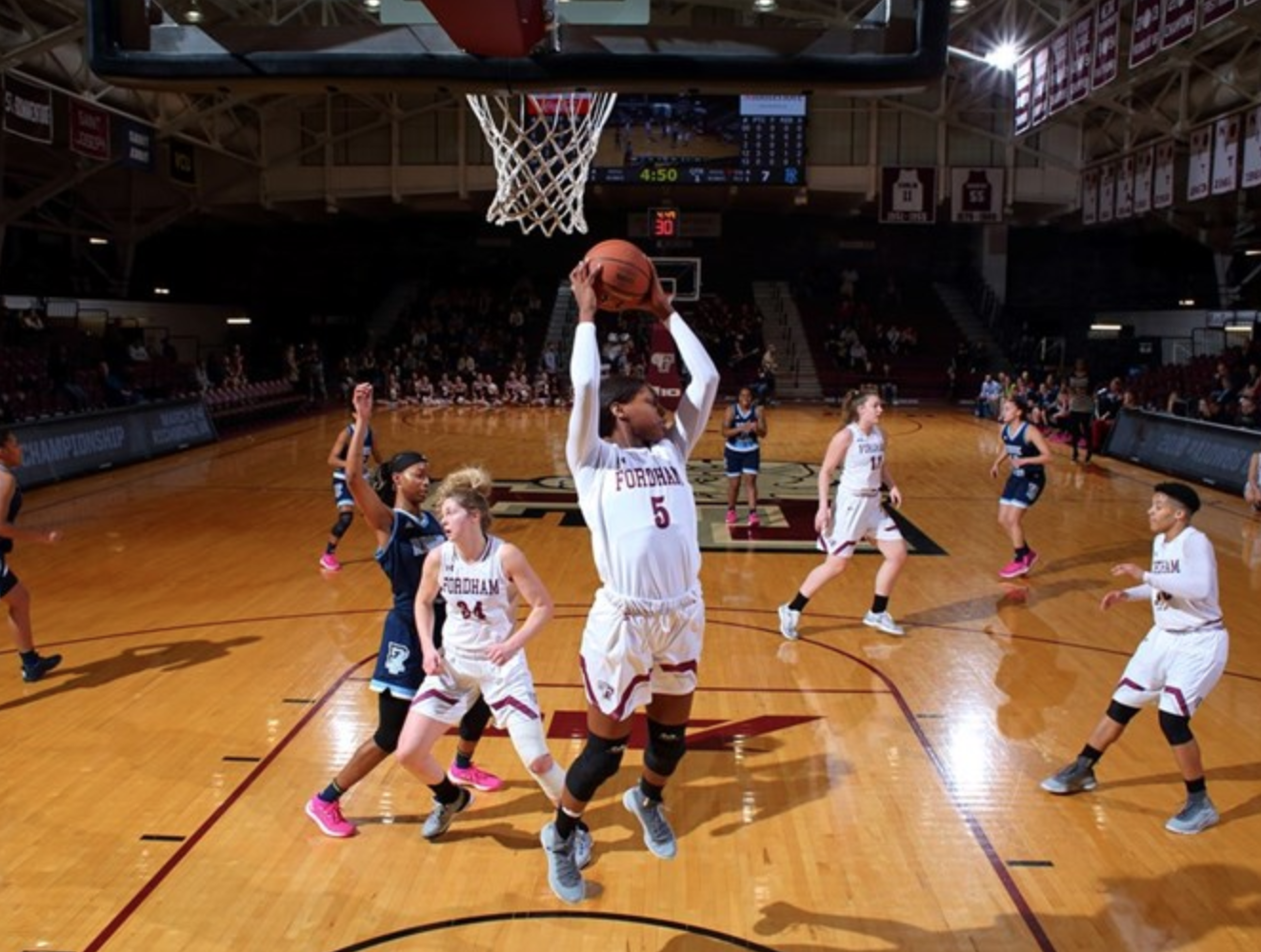G'mrice Davis pulls down one of her game-high 16 rebounds. (Courtesy of Fordham Athletics)