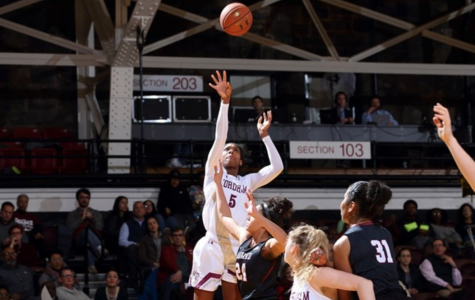 G'mrice Davis takes a jumpshot against Harvard. (Courtesy of Fordham Athletics)