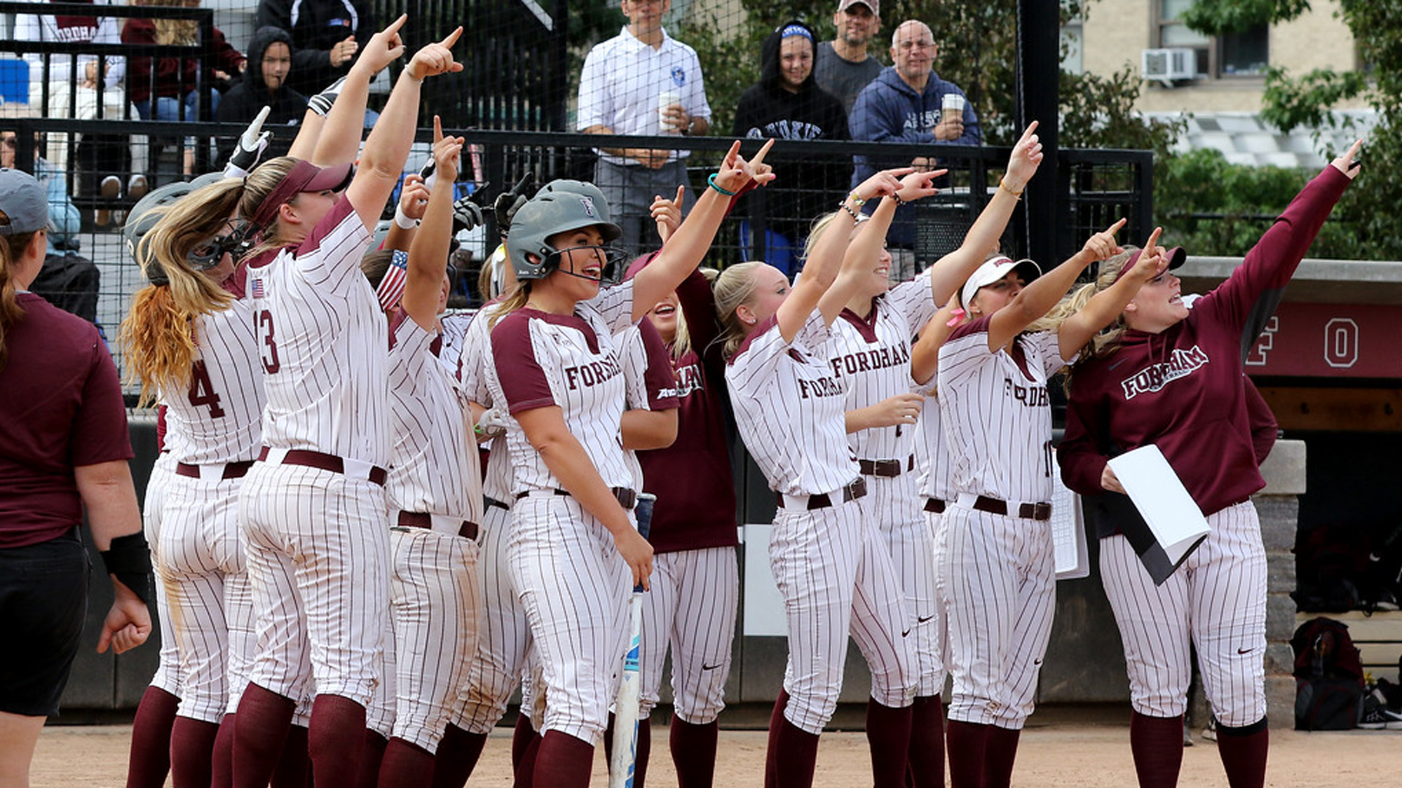 The softball team does their traditional home run celebration (Courtesy of Fordham Athletics).
