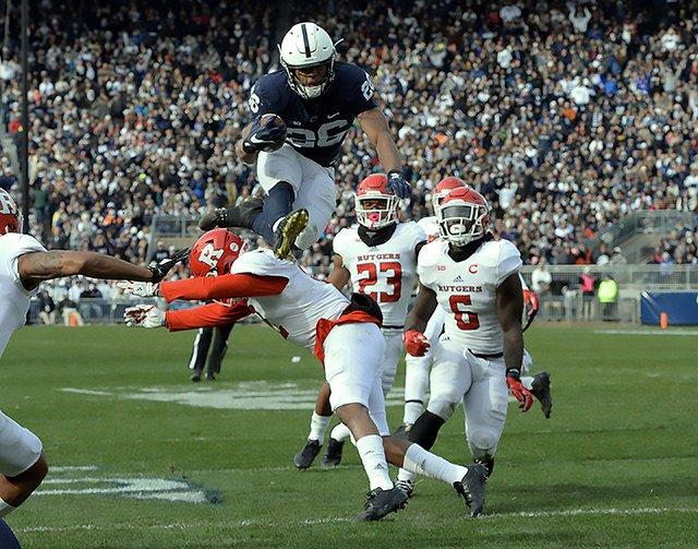 Saquon+Barkley+hurdles+a+Rutgers+defender+%28a+metaphor+for+both+his+and+Rutgers%27+career.%29+%28Courtesy+of+Twitter%29