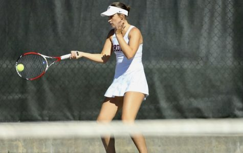 Arina Taluyenko hits a forehand. She went 6-0 this weekend at Harvard (Courtesy of Fordham Athletics).