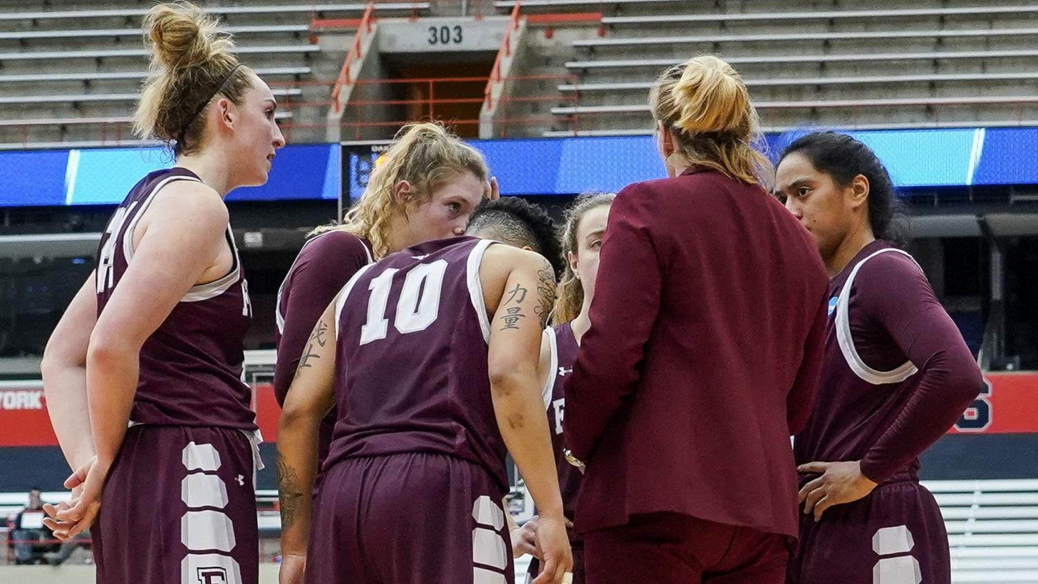 Fordham huddles as a team during Saturday's loss to Syracuse. (Courtesy of Fordham Athletics)