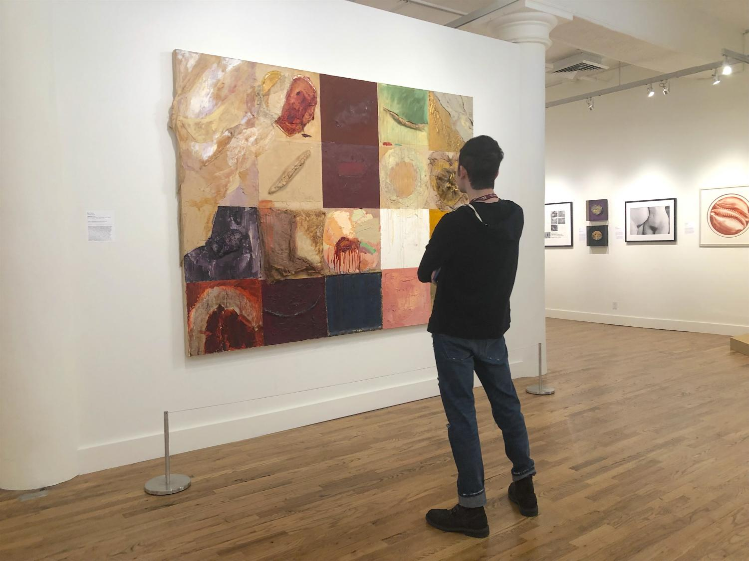 Liam Otero FCRH '20 looks at a work of art at the exhibit. (Sophia Giatzis/ The Fordham Ram)
