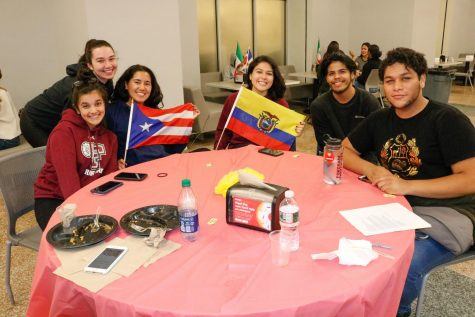 Students enjoy food and hold flage at El Grito