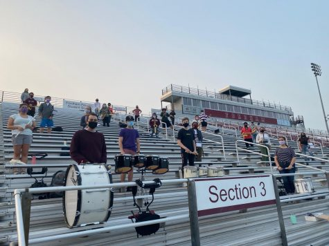Fordham Pep Band members practice social distancing on the football bleachers while rehearsing. (Courtesy of Fordham Pep Band)
